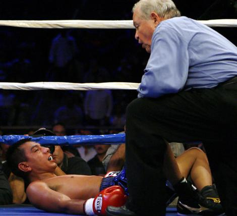 Referee Lou Moret counts Cristian Mijares out after the Mexican was knocked down in the ninth round by Australian Vic Darchinyan in Las Vegas.